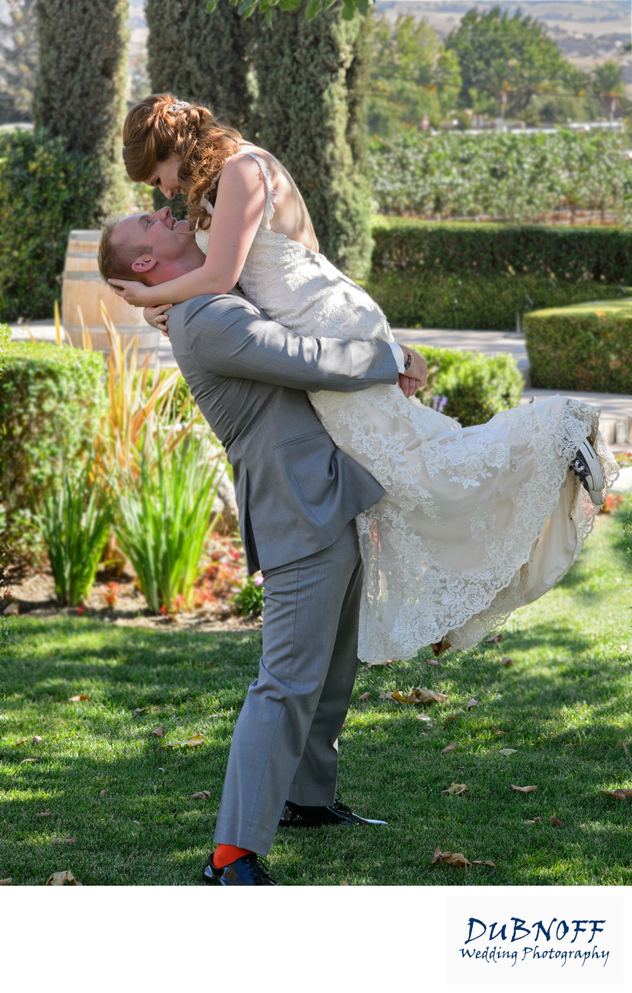 Groom Lifting Bride at Garre Vineyards in Livermore
