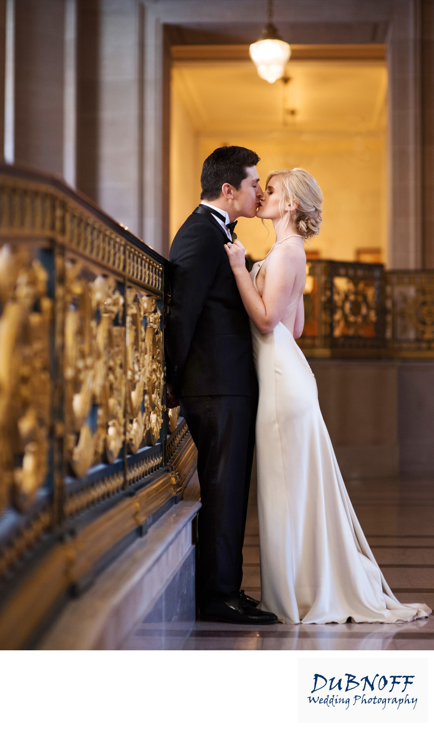 San Francisco City Hall Wedding Photographers - Railing Kiss