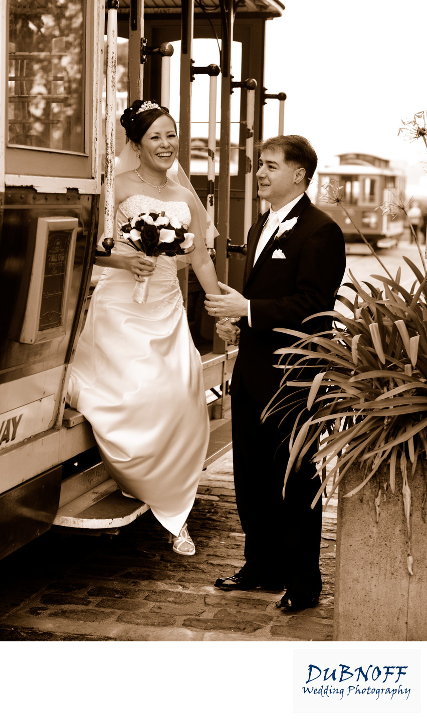 Newlywed Groom Assists Bride Stepping off a Cable  Car in Sepia Tone