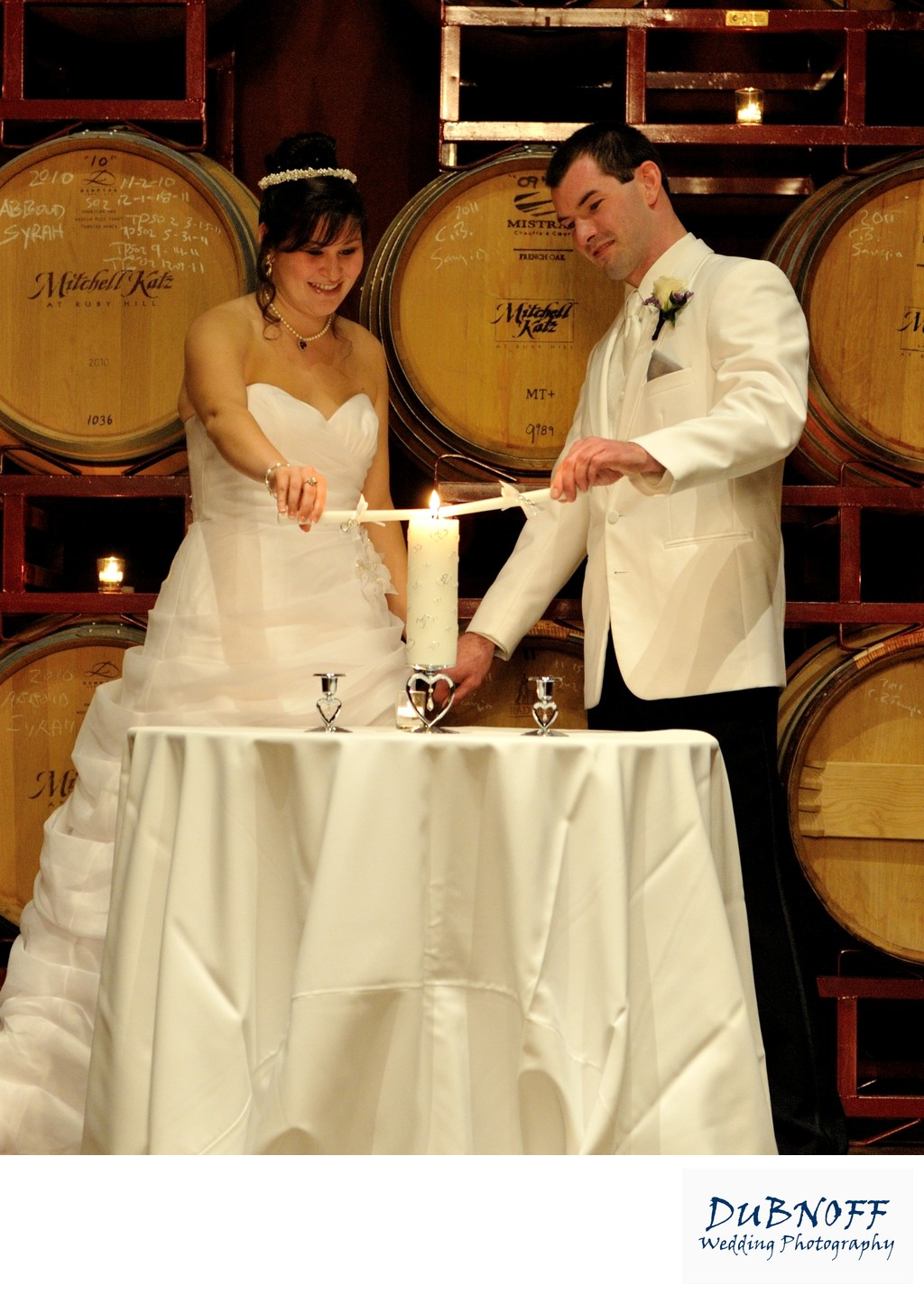 Bride and Groom Lighting Candles at the Palm Event Center
