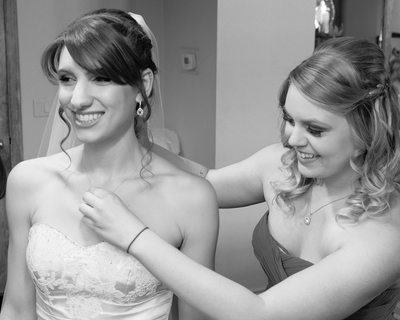 brides necklace being fitted by bridesmaid in Bay Area