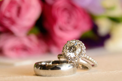 rings and flowers at wedding close up detail image.
