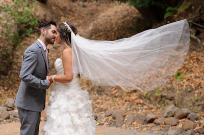 bride and groom kiss at Wildwood Acres in Moraga