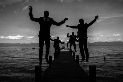 Groomsman  and Groom Jumping Close Lake Tahoe