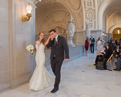 city hall ceremony kiss, a candid wedding photography example