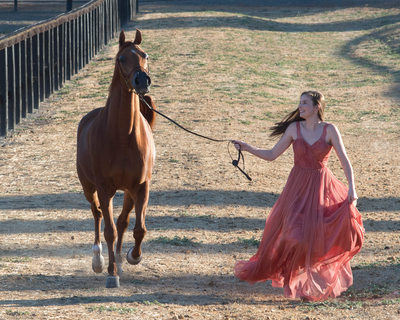 Horse Photography with High School Senior running with Dress Flowing