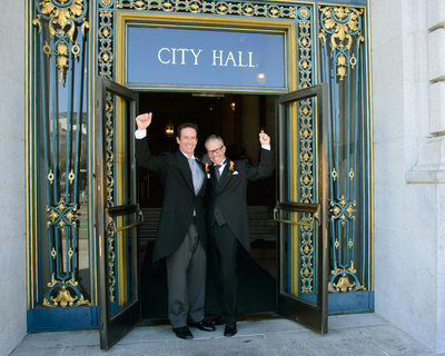 LGBTQ Grooms celebrating outside of San Francisco City Hall