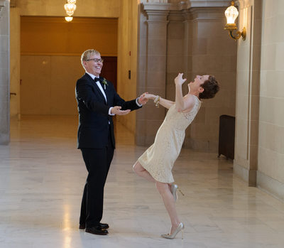 Wedding Photography at SF City Hall - Dancing LGBTQ  Brides