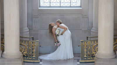 SF City Hall Gay Wedding with LGBTQ Brides Having Fun for Photography