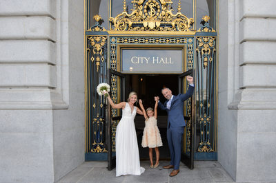 Woo Hoo!  Couple leaving San Francisco city hall with daughter