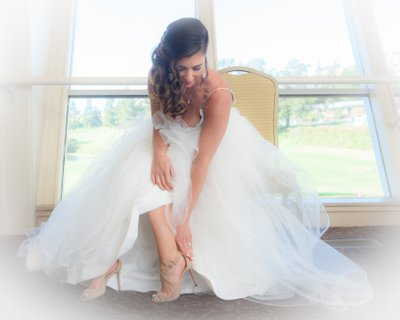 Dreamy Bridal Prep Photo as Bride Puts on her Shoes