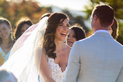 Bride Laughing during wedding vows.  San Francisco Bay Area Photography