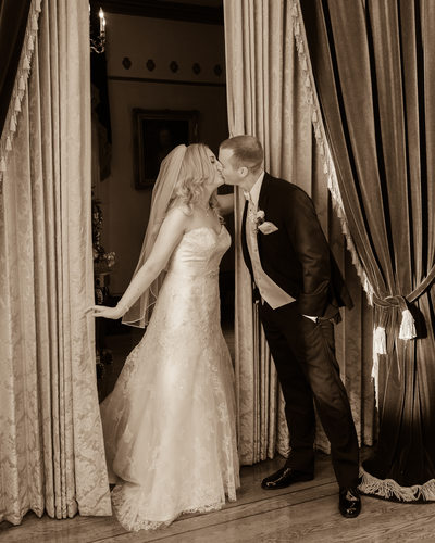 first look wedding kiss in Sepia Tone Photography