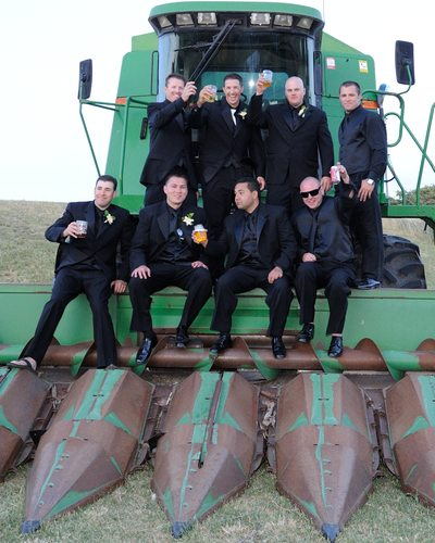 groomsmen on farm equipment