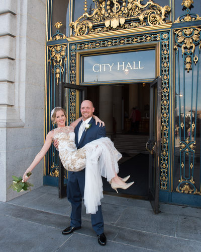 A San Francisco City Hall Bride and Groom posing