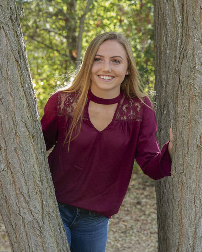 Natural Frame for Outdoor High School Senior Portrait in Clayton