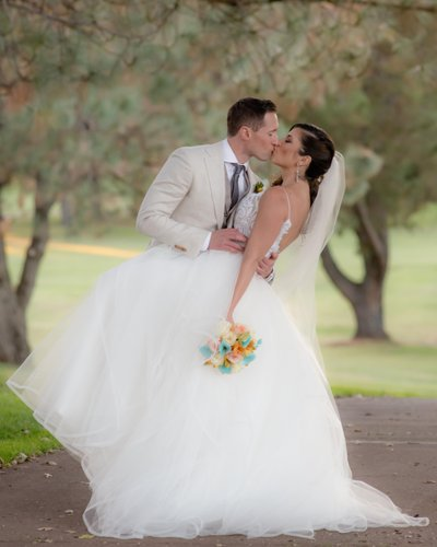 Bride kissing Groom on Bay Area Golf Course in San Francisco
