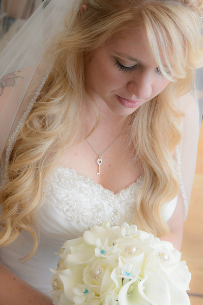 Bay Area Bride Looking Down at Wedding Bouquet