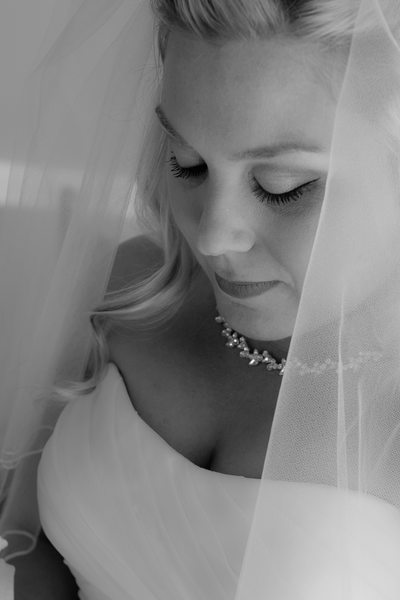 Beautiful Bride Looking Down with Face Framed by Veil