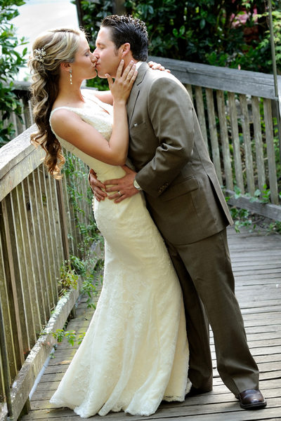 Bride and Groom Kissing on a Bridge in San Francisco