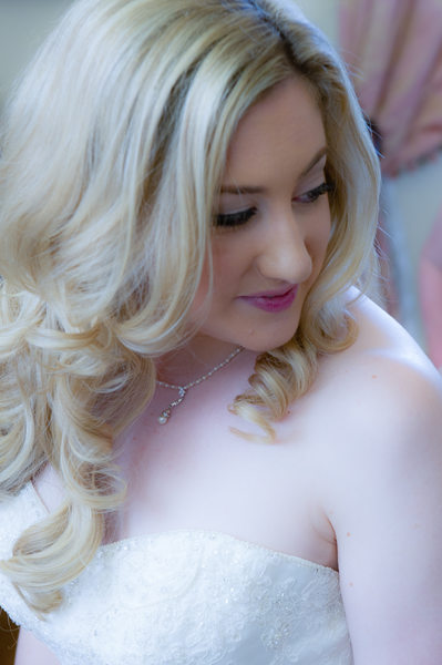 bride looking over shoulder during portrait photography