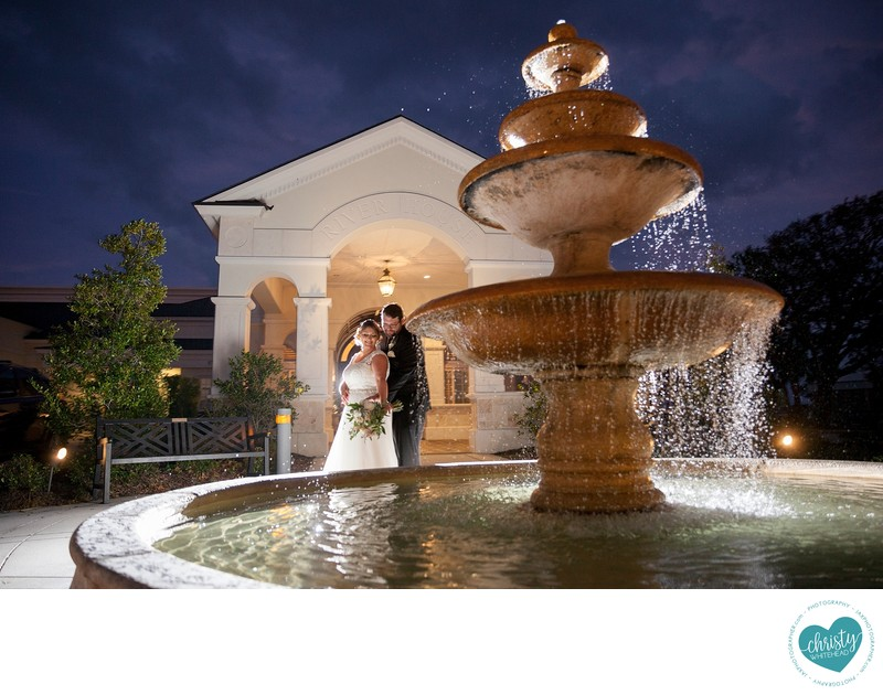 The River House fountain with couple