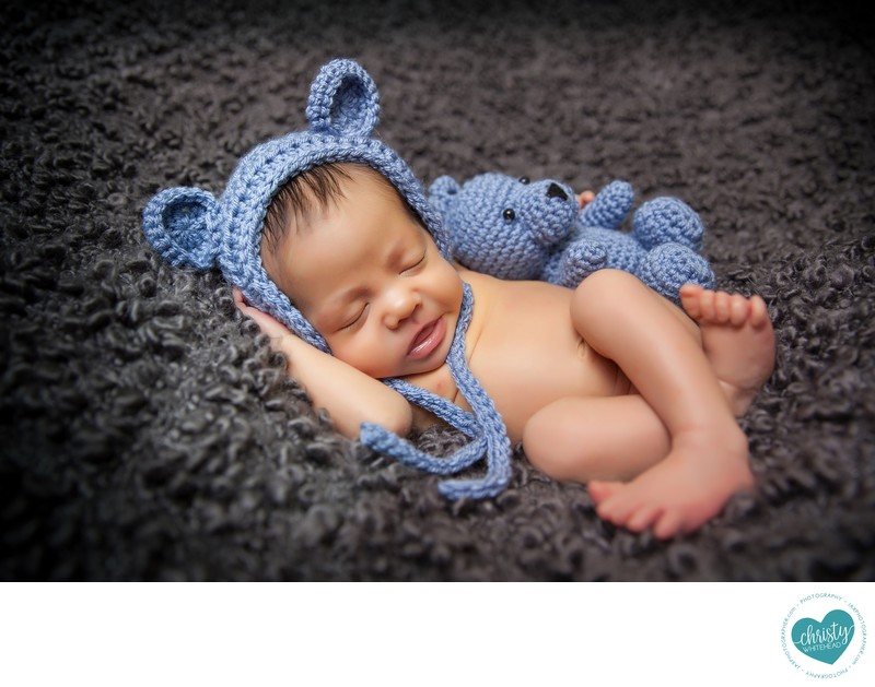 Sweet newborn with blue bear