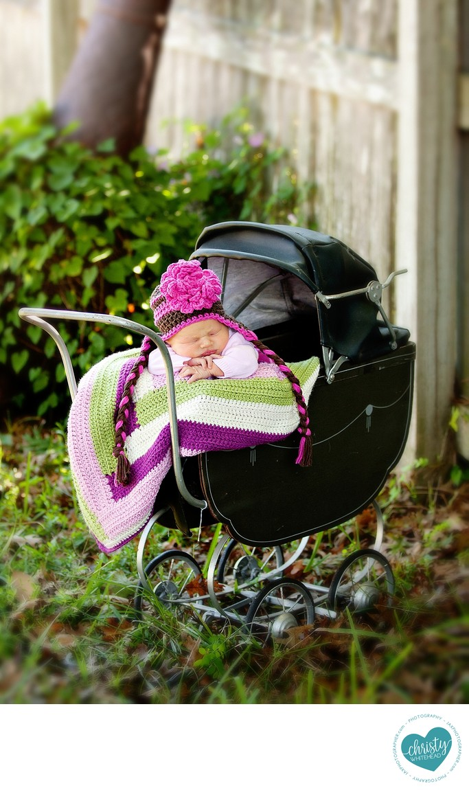 Newborn session at home in vintage doll carriage