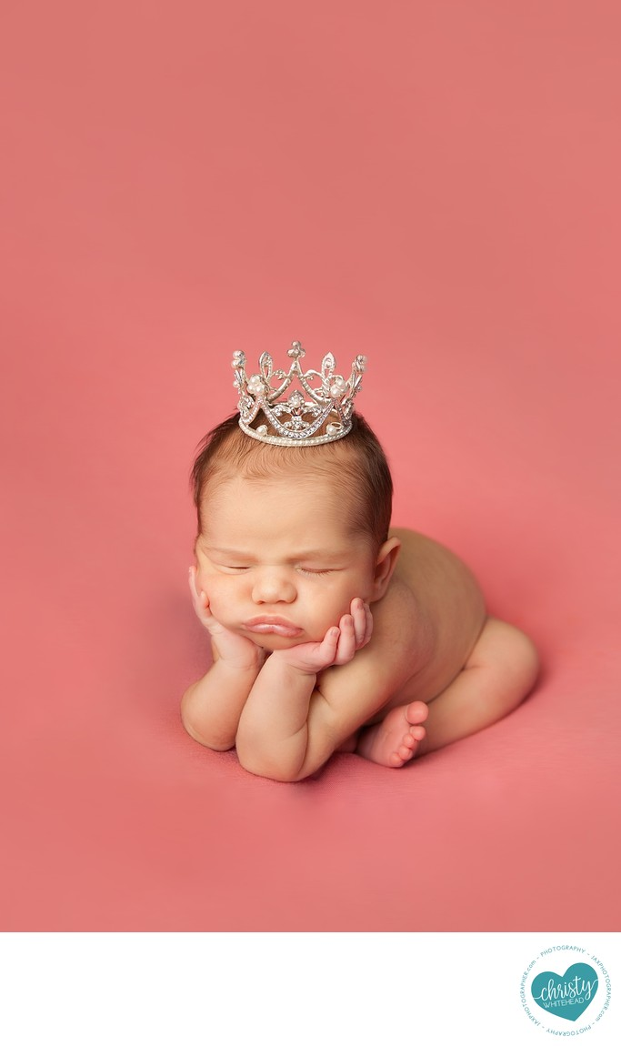 Little princess with crown on peachy pink