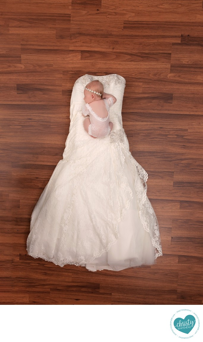 Little girl on mommas wedding dress, lace