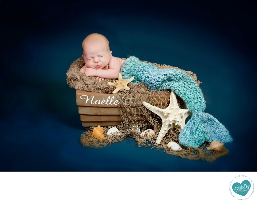 Newborn Baby In A Mermaid Tail On A Tiny Boat JAX