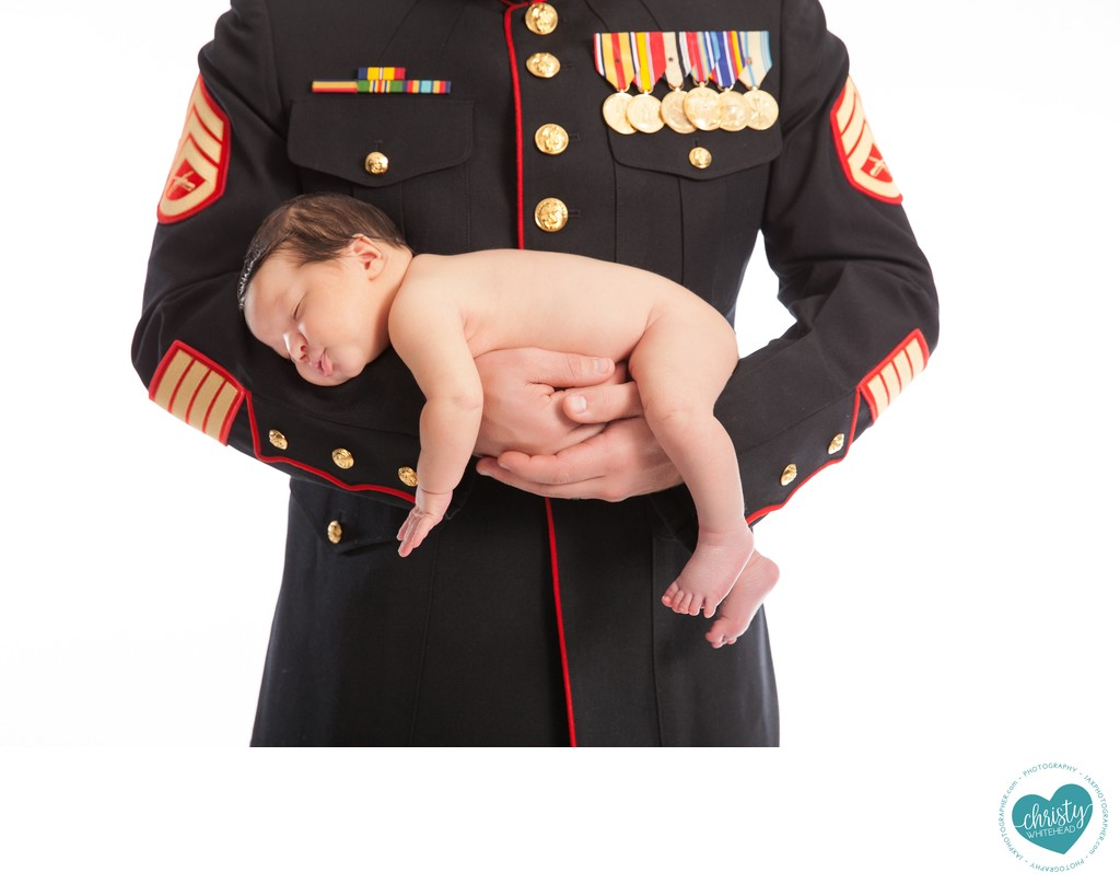 Marine holding newborn photo Shoot JAX Florida