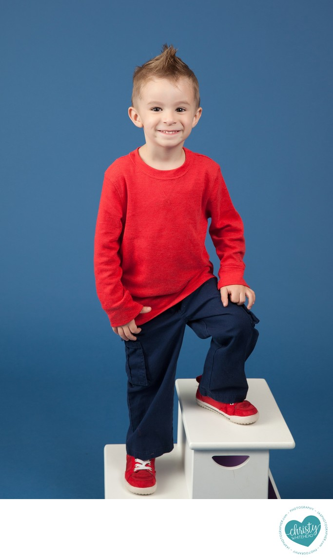 Little Boy Wearing A Red Shirt With Red Shoes JAX