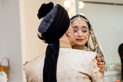 Indian bride crying over first look with dad