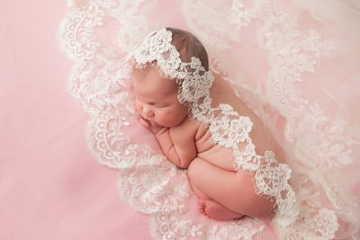 Momma's wedding veil over sweet baby