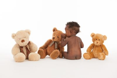 Little Boy With Teddy Bears