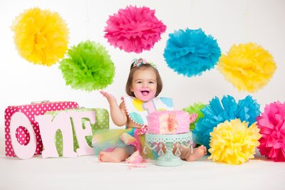 Colorful one year old cake smash