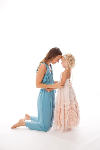 Mom And Daughter In Studio During Photo Shoot