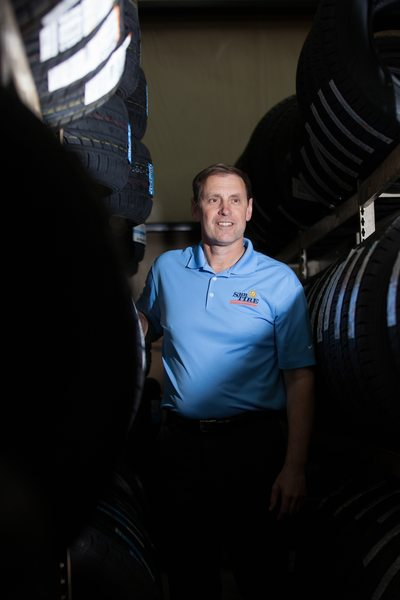 Portrait of a manager on location at Sun Tire