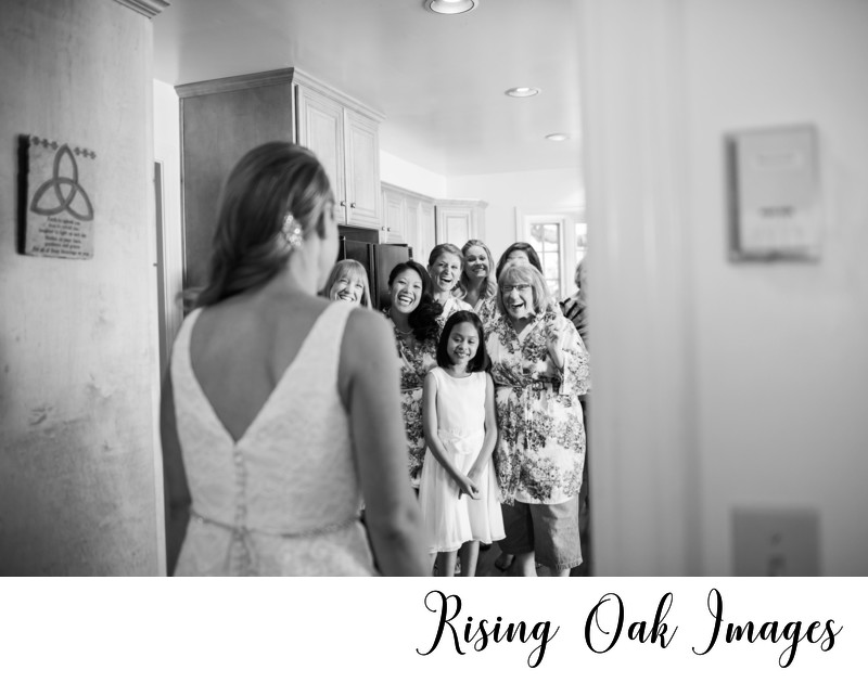 Bride stuns bridesmaids and mother first look
