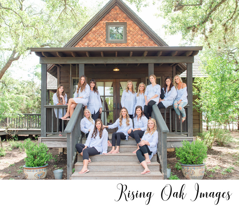 Bridesmaids sit on porch at Camp Lucy Dripping Springs