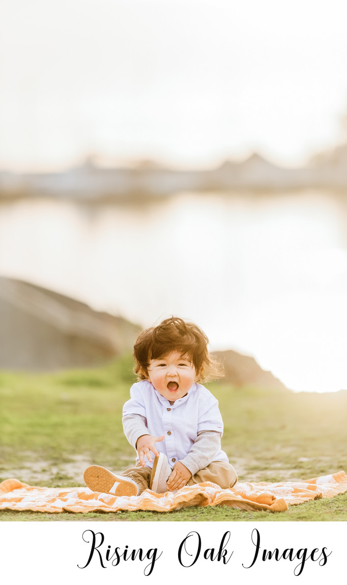 Little boy laughs for camera at Brushy Creek Lake Park