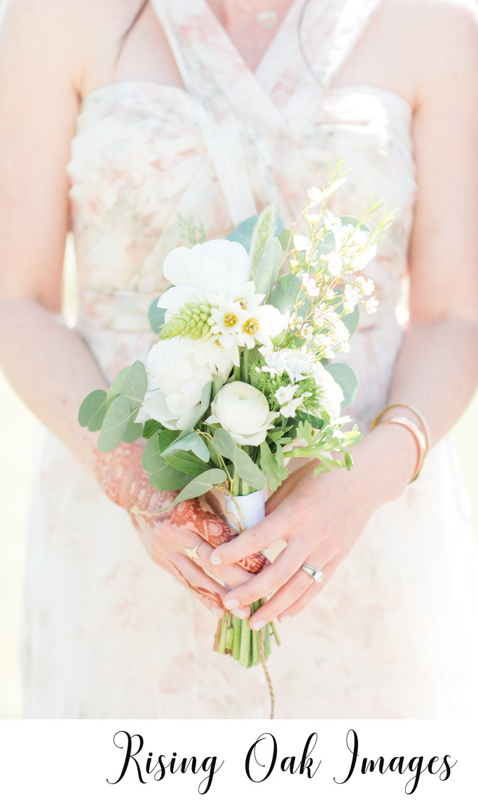 Bridesmaid shows off henna and bouquet in Dripping Springs venue