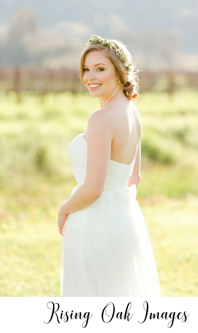 Bride looks over shoulder in Dripping Springs