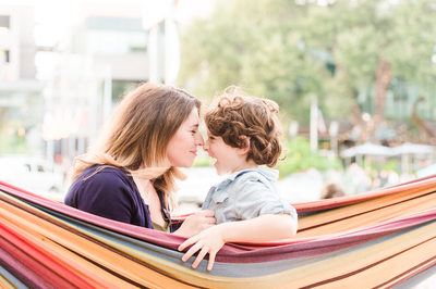 Mom and her son in a hammock on South Congress Ave