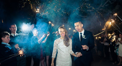 Bride and Groom laughing during sparkler exit in Dripping Springs Austin