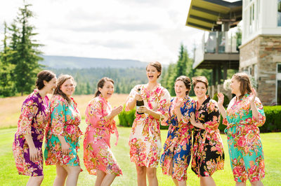Bridesmaids pop a bottle of champagne in Snoqualmie wedding