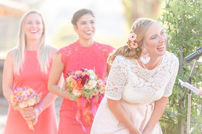 Dripping Springs bride laughs during sunset ceremony