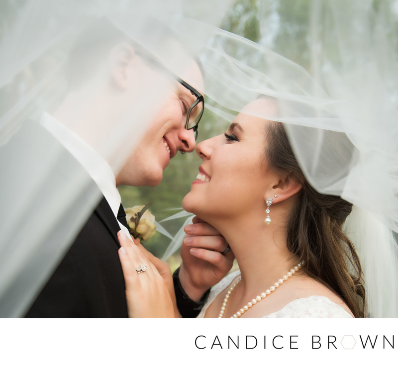 bride and groom under veil- baton rouge wedding