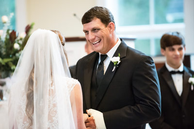 Groom Smiles in St Francis at the Point Ceremony